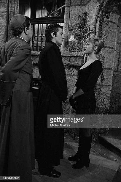 French actors Paul Meurisse Alain Delon with his former wife actress Nathalie Delon on the set of Doucement les basses written and directed by...