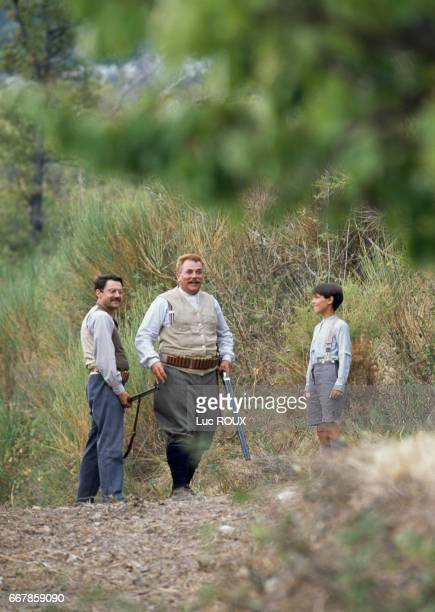French actors Philippe Caubere Didier Pain and Julien Ciamaca on the set of La Gloire de Mon Pere directed by Yves Robert
