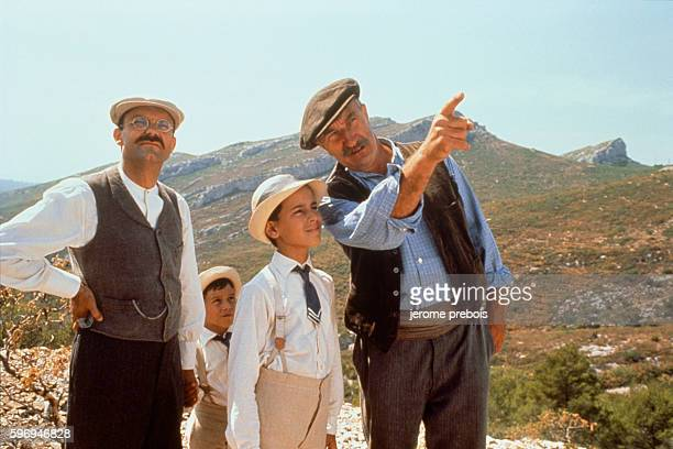 French actors Philippe Caubere Julien Ciamaca and Pierre Maguelon on the set of the film La Gloire de Mon Pere directed by Yves Robert
