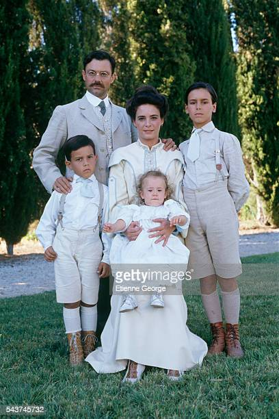 French actors Philippe Caubere Nathalie Roussel 11yearold Julien Ciamaca and two other child costars during the shooting of Yves Robert's film Le...