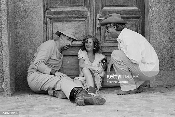 French actors Philippe Noiret and Isabelle Huppert with director and screenwriter Bertrand Tavernier on the set of his movie Coup de Torchon |...