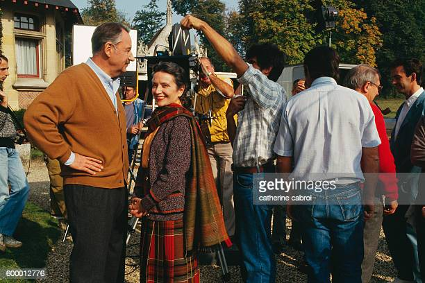 French actors Philippe Noiret and Monique Chaumette during the filming of the movie Masques directed by Claude Chabrol