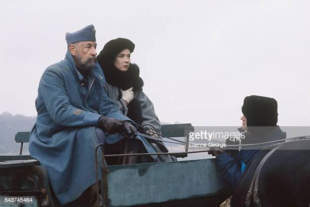 """French actors Philippe Noiret and Sabine Azema directed by Bertrand Tavernier on the set of the film """"La Vie et rien d'autre"""" , for which Noiret won..."""