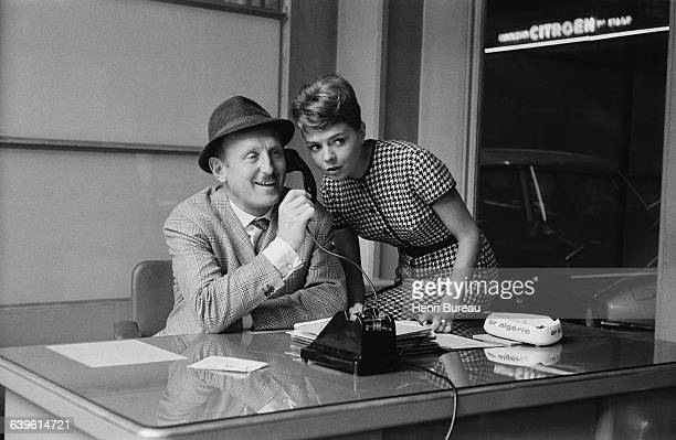 French actors Pierrette Brunoy and Bourvil on the set of the film Le Tracassin ou les Plaisirs de la Ville written and directed by Alex Joffe