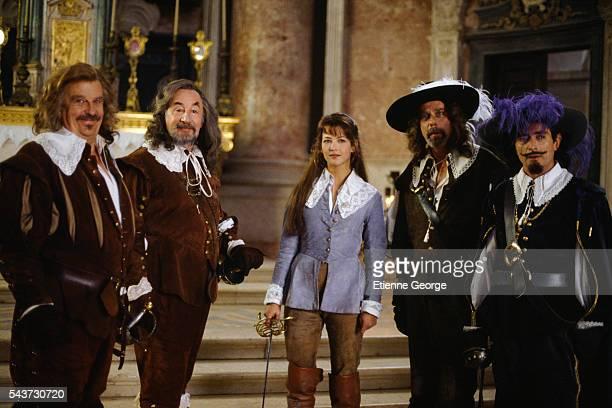 French actors Raoul Billerey Philippe Noiret Sophie Marceau JeanLuc Bideau and Sami Frey on the set of the film La fille de d'Artagnan directed by...