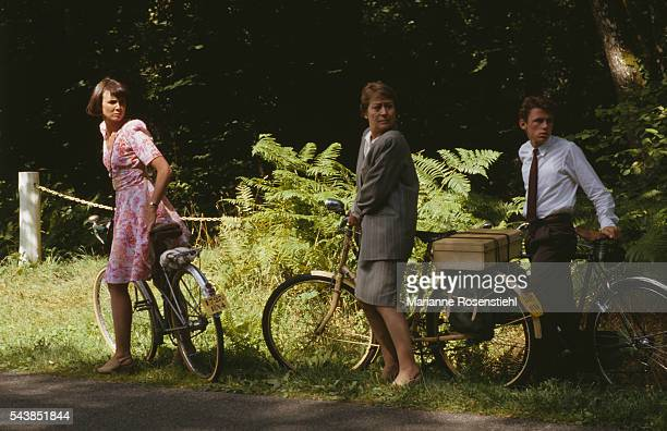 French actors Sabine Azéma Matthieu Rozé and Annie Girardot on the set of Five Days in June by French director composer screenwriter and actor Michel...