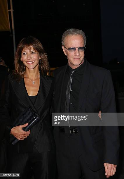French actors Sophie Marceau and Christophe Lambert are pictured during the inauguration ceremony of the Cite du cinema a film studios complex...
