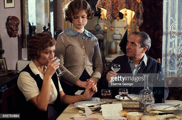 French actors Stephane Audran Isabelle Huppert and Jean Carmet on the Set of the Film Violette Noziere directed by French director Claude Chabrol...