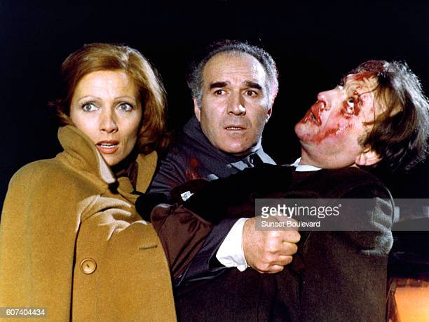 French actors Stephane Audran Michel Piccoli and Claude Pieplu on the set of Les noces rouges written and directed by Claude Chabrol