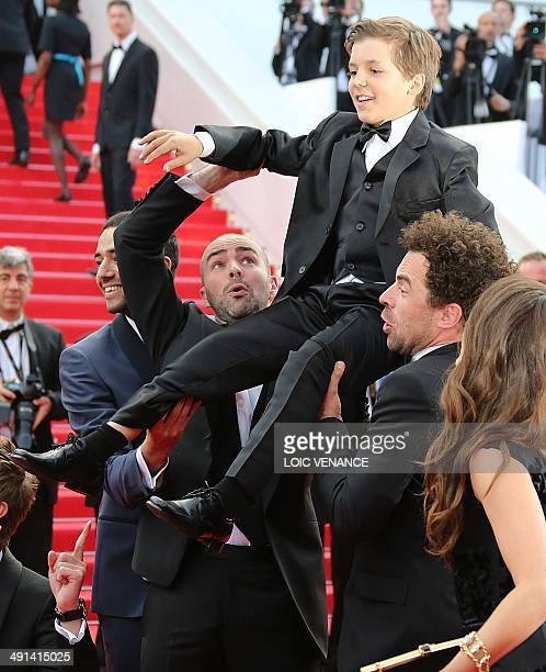 French actors Tarek Boudali Julien Arruti and Gregoire Ludig carry actor Enzo Tomasini next to French actress Alice David as they arrive for the...