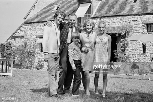 French actors Xavier Gelin Jean Richard Danielle Darrieux and Jacqueline Coue on the set of La Maison de Campagne directed by Jean Girault