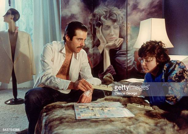 French actors Xavier SaintMacary and Josiane Balasko on the set of the film Les Hommes Preferent les Grosses directed by French director JeanMarie...