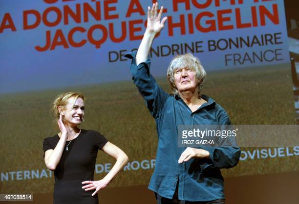 French actor/singer Jacques Higelin acknowledges applause as French actress Sandrine Bonnaire watches prior to the screening of Bonnaire's film 'Ce...