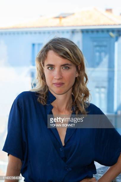 French actress Adele Haenel poses during a photocall of the film Portrait de la jeune fille en feu during the 12th Francophone Angouleme Film...