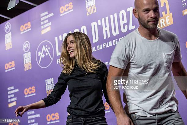 French actress Adrianna Gradziel and French actor Franck Gastambide leave after posing during a photocall at the 18th international comedy film...