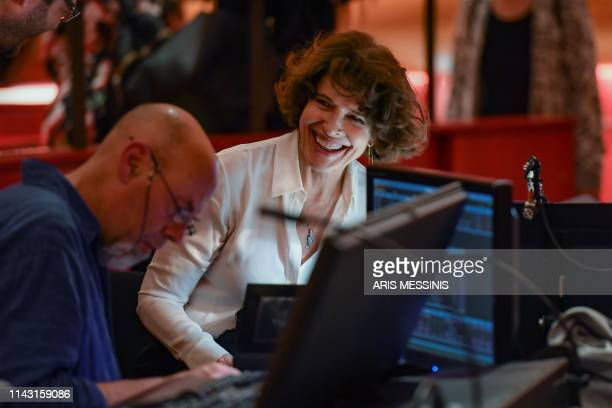 French actress and director Fanny Ardant smiles during a general rehearsal of 'Lady Macbeth of Mtsensk' an opera by Russian composer Dmitri...
