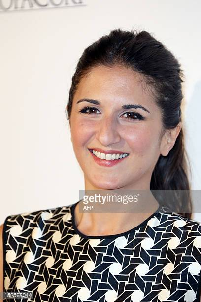 French actress and director Geraldine Nakache poses as she arrives to attend the inauguration ceremony of the Cite du cinema a film studios complex...