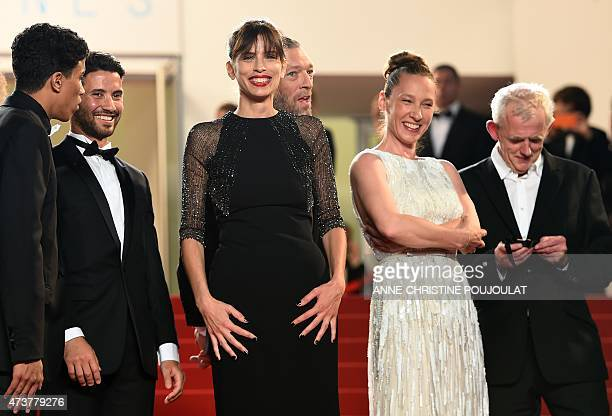 French actress and director Maiwenn poses with French actor Nabil Kechouhen, French actor Abdel Addala, French actor Vincent Cassel and French...