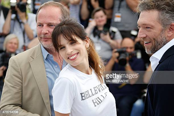 """French actress and director Maiwenn poses with French screenwriter Etienne Comar and French actor Vincent Cassel during a photocall for the film """"Mon..."""