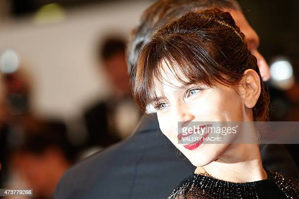 """French actress and director Maiwenn smiles as she arrives for the screening of the film """"Mon Roi"""" at the 68th Cannes Film Festival in Cannes,..."""