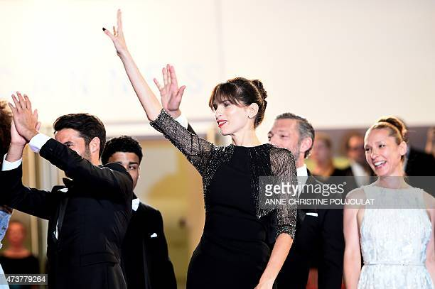 """French actress and director Maiwenn waves as she arrives with her cast for the screening of the film """"Mon Roi"""" at the 68th Cannes Film Festival in..."""