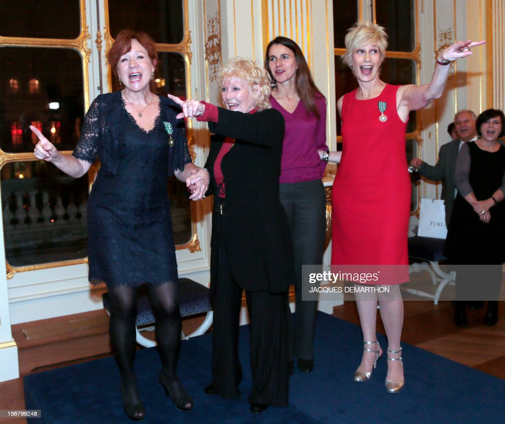 French actress and film maker Eva Darlan (L), British singer Petula Clark (2ndL) and French radio host and former singer Valli (R) gesture as they pose with French Culture Minister Aurelie Filippetti (2ndR) after been awarded as Knight for Darlan and Valli and Commander for Clark, in the Order of Arts and Letters during a ceremony at the ministry in Paris, on November 21, 2012. DEMARTHON