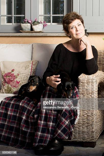 French actress and former Bond Girl in 1979 James Bond film Moonraker Corinne Clery poses with her dogs in her countryhouse in Tuscania Italy