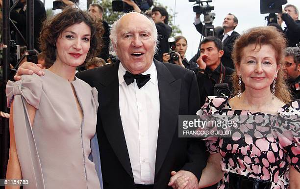 French actress and member of the Jury Jeanne Balibar actor Michel Piccoli and his wife Ludivine Clerc pose as they arrive to attend the screening of...