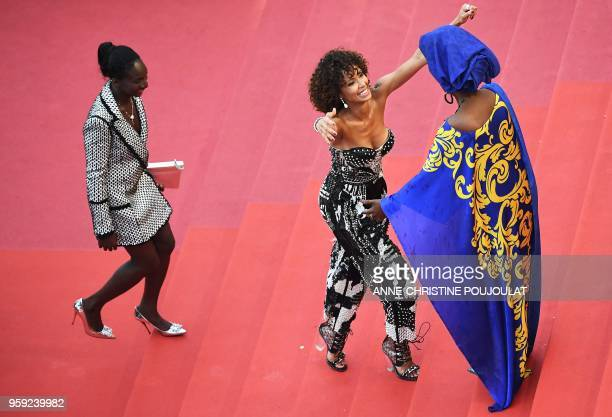 French actress and Miss France 2000 Sonia Rolland is welcomed by Burundian singer and member of the Feature Film Jury Khadja Nin as she arrives with...