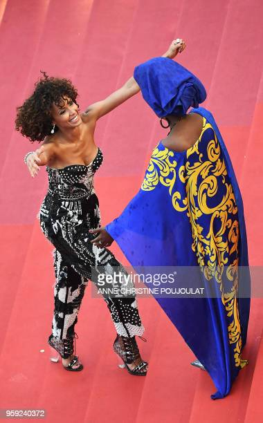 French actress and Miss France 2000 Sonia Rolland is welcomed by Burundian singer and member of the Feature Film Jury Khadja Nin as she arrives on...
