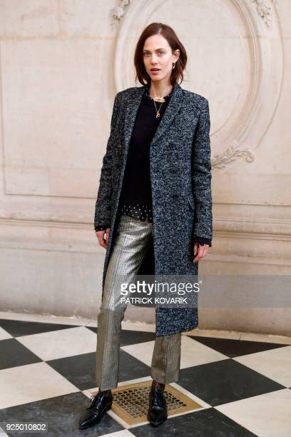 French actress and model Aymeline Valade poses for a photocall before the Christian Dior's 2018/2019 fall/winter collection fashion show on February...