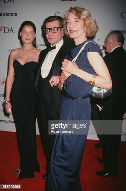 French actress and model Laetitia Casta French fashion designer Yves Saint Laurent and fashion muse and designer Loulou de la Falaise attend the 18th...