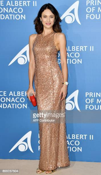 French actress and model of Ukrainian origin Olga Kurylenko poses as she attends the MonteCarlo Gala for the Global Ocean in Monaco on September 28...