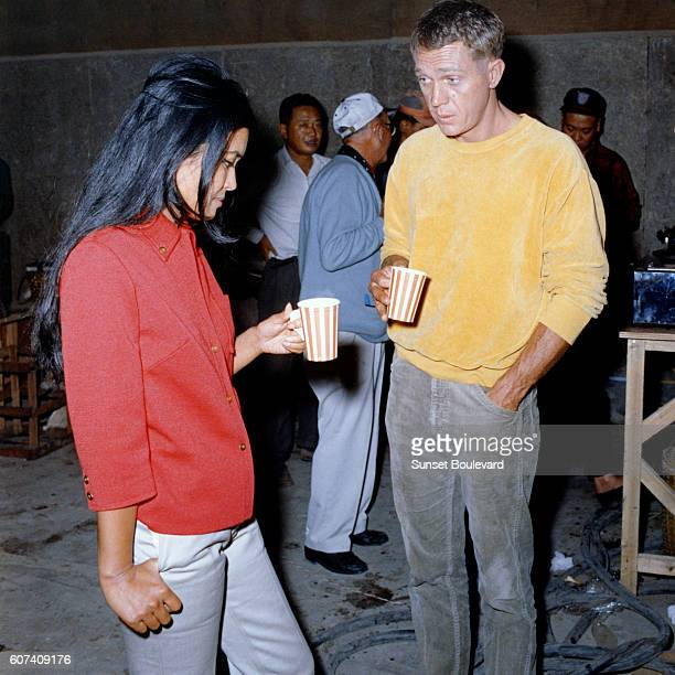 French actress and novelist of Eurasian origin Marayat Andriane aka Emmanuelle Arsan and American actor Steve McQueen on the set of The Sand Pebbles...