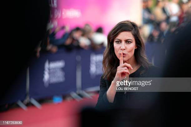 French actress and president of the Revelation Jury Anna Mouglalis poses on the red carpet during the 45th Deauville US Film Festival where she...