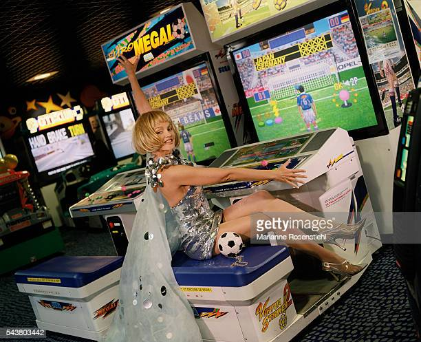 French actress and singer Arielle Dombasle lends her support during the 1998 Soccer World Cup at Stade de France