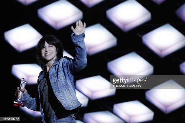 TOPSHOT French actress and singer Charlotte Gainsbourg celebrates after receiving the best female artist award during the 33rd Victoires de la...