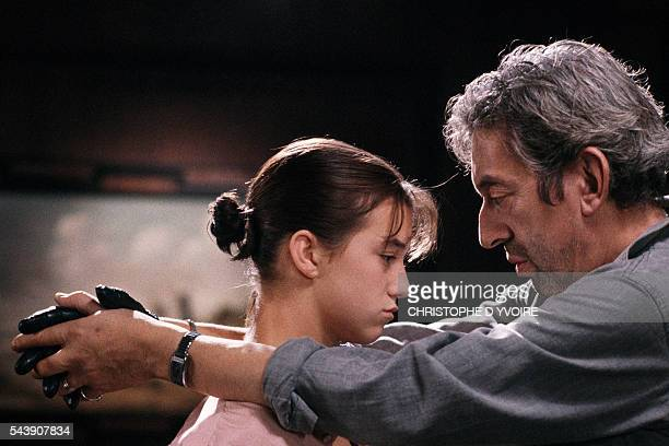 French actress and singer Charlotte Gainsbourg with her father, French singer, songwriter, actor, and director on the set of a music video for her...