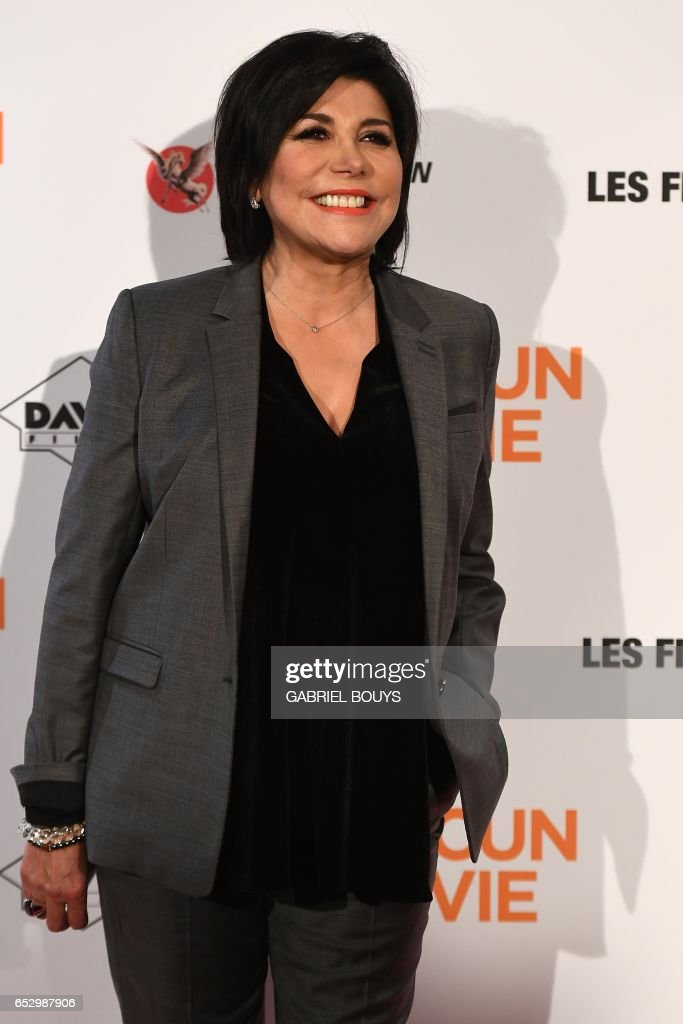 French actress and singer Liane Foly poses during the photocall for the premiere of the film 'Chacun Sa Vie' in Paris on March 13, 2017. The film is directed by French director Claude Lelouch. /