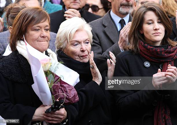 French actress and singer Line Renaud applauds next to actress Annie Girardot's daughter Giulia Salvatori and granddaughter Lola Vogel , as...