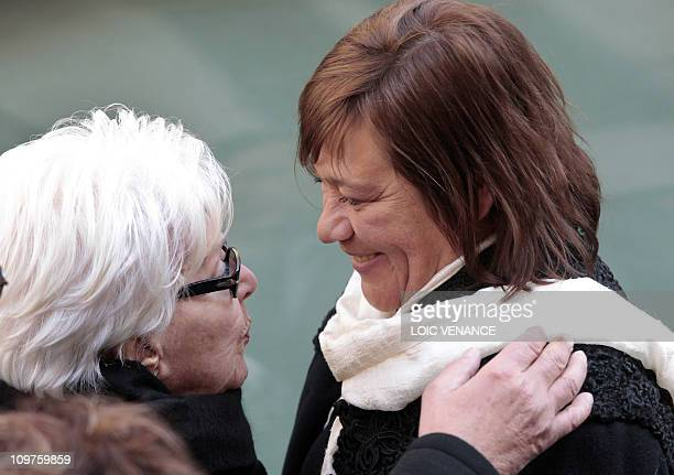 French actress and singer Line Renaud comforts actress Annie Girardot's daughter Giulia Salvatori, while leaving the Paris Saint-Roch church at the...