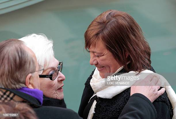 French actress and singer Line Renaud comforts actress Annie Girardot's daughter Giulia Salvatori while leaving the Paris SaintRoch church at the end...