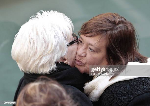 French actress and singer Line Renaud kisses actress Annie Girardot's daughter Giulia Salvatori, while leaving Saint-Roch church after Girardot's...