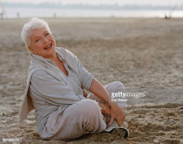 French actress and singer Line Renaud relaxes on the beach in La BauleEscoublac France