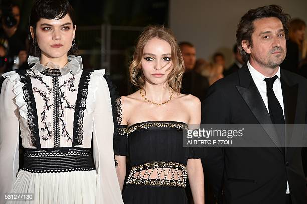 French actress and singer Stephanie Sokolinski aka Soko FrenchUS actress LilyRose Depp and French actor LouisDo de Lencquesaing pose on May 13 2016...