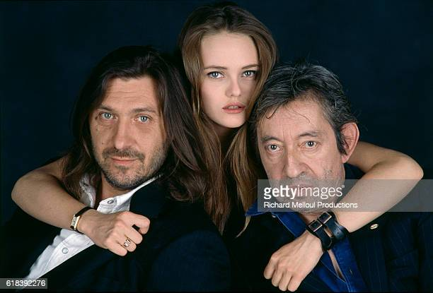 French actress and singer Vanessa Paradis wraps her arms around French composer Franck Langolff and French actor singer and composer Serge Gainsbourg
