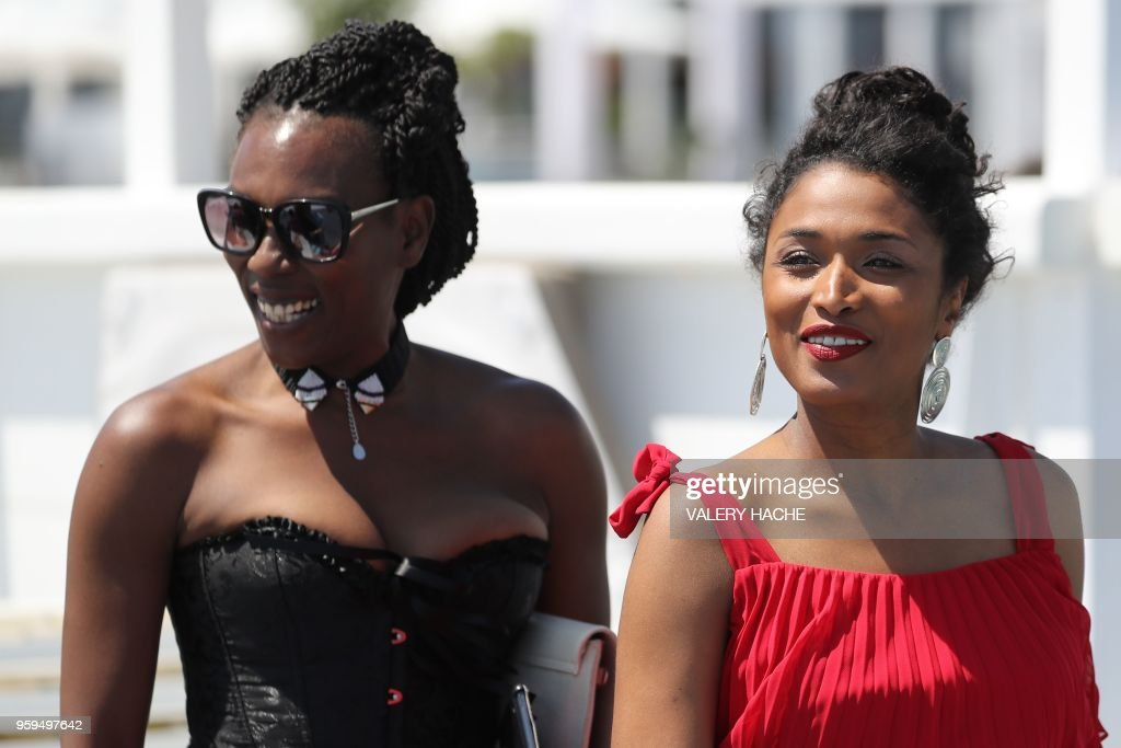 French actress and writer Mata Gabin (L) and French-Portuguese actress Sara Martins, members of a group of 16 black women who fight for equality and inclusion of black women in the French film industry, pose on May 17, 2018 during a photocall for the book 'My Profession is Not Back' on the sidelines of the 71st edition of the Cannes Film Festival in Cannes, southern France.