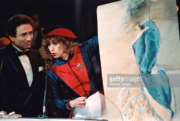 French actress Anemone comments her portrait after being awarded 12 March 1988 in Paris a Cesar statue by French TV presenter Michel Drucker 12 March...