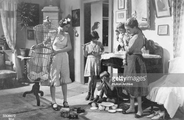 French actress Annabella with children in a scene from the Hungarian film 'Tavaszi zapor ' directed by Pal Fejos for DuWorld Pictures