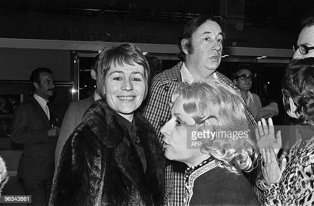 French actress Annie Girardot actor Philippe Noiret and writer Christine de Rivoyre arrive at the Champs Elysees cinema on March 17 1972 to attend...